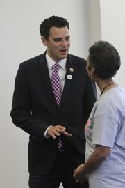 Congressman Kevin Yoder talks with Kansas University Libraries Dean Lorraine Haricombe on Wednesday at KU's Watson Library.