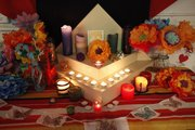 An altar created for Día de los Muertos is seen Friday at the Lawrence Percolator. The Percolator will have a grand celebration for the Mexican holiday this Friday that will feature food, artists and music.
