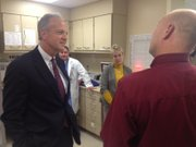 Sen. Jerry Moran speaks with LMH pharmacist Greg Burger about the hospital pharmacy's use of electronic medical records in the administration of medicine.