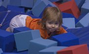 Rumbling through some sponge blocks, Alexandra Kaufman, 19 months, plays at Lawrence Gymnastics, 5150 Clinton Parkway, which allows parents and children to take a class together.