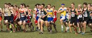 Free State's Trail Spears, center, runs in a pack of runners at the start of the boys class 6A state cross country championship race Saturday, Oct. 27, 2012 at Rim Rock farm.