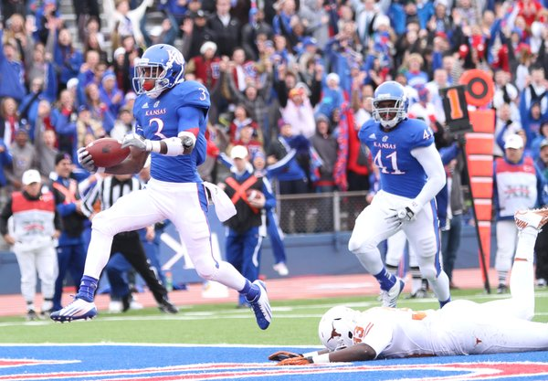 Kansas receiver Tony Pierson leaps into the endzone as he leaves Texas linebacker Steve Edmond on the turf during the second quarter on Saturday, Oct. 27, 2012 at Memorial Stadium.