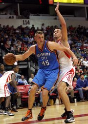 Former Oklahoma City Thunder center Cole Aldrich (45) drives on Houston Rockets' Donatas Motiejunas during an NBA preseason basketball game on Oct. 10, 2012, in Hidalgo, Texas. The Thunder sent Aldrich to the Rockets as part of the James Harden trade on Saturday night.