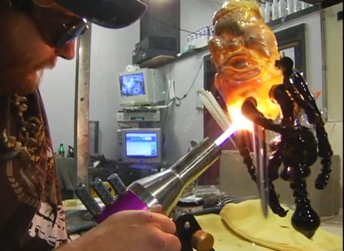 "A screenshot from the trailer for ""Degenerate Art,"" a documentary on glass pipe-making."