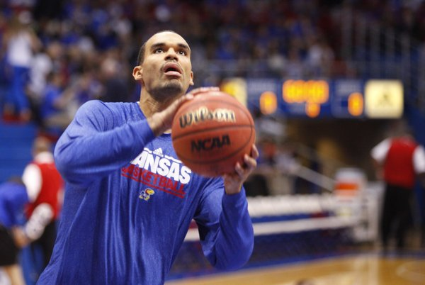 Kansas freshman Perry Ellis heads up to the bucket during warmups before tipoff of an exhibition against Emporia State, Tuesday, Oct. 30, 2012 at Allen Fieldhouse.
