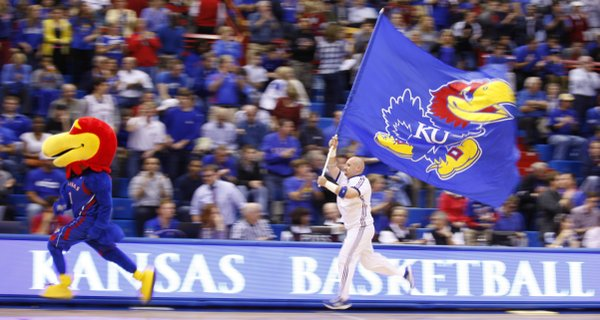 The Jayhawk and the KU flag lead the way out onto the court prior to tipoff against Emporia State, Tuesday, Oct. 30, 2012 at Allen Fieldhouse.