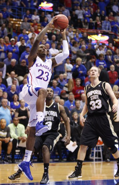 Kansas guard Ben McLemore elevates for a dunk before Emporia State players Chris Sights (3) and Michael Harris (33) during the first half, Tuesday, Oct. 30, 2012 at Allen Fieldhouse.