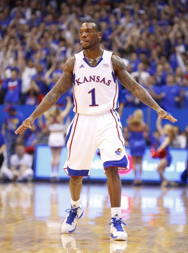 """Kansas guard Naadir Tharpe signals """"three"""" after hitting a three-pointer against Emporia State during the first half, Tuesday, Oct. 30, 2012 at Allen Fieldhouse."""