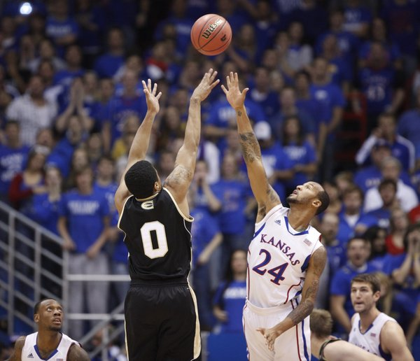 Kansas guard Travis Releford gets up to defend against a shot from Emporia State guard Kaleb Wright during the first half, Tuesday, Oct. 30, 2012 at Allen Fieldhouse.
