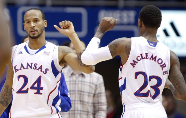 Kansas teammates Travis Releford (24) and Ben McLemore bump elbows after a bucket by McLemore against Emporia State during the first half, Tuesday, Oct. 30, 2012 at Allen Fieldhouse.