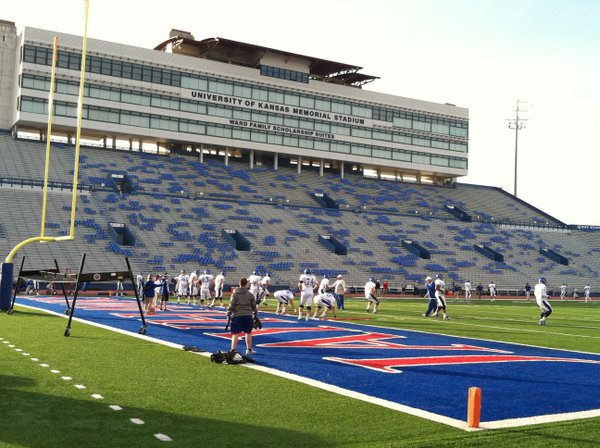 KU's offensive line runs through a tough workout with O-Line coach Tim Grunhard at the start of Wednesday's practice.