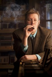 Regarding the social aspect of managing a cigar shop, Bryan Newbury compares it to hosting an ongoing party. Newbury is pictured at Centro Cigars, 4811 Bob Billings Parkway on Wednesday, Oct. 31, 2012.