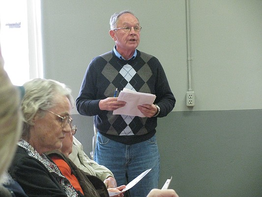 Paul Bahnmaier speaks Friday against a proposal to reduce the hours of the Lecompton Post Office.