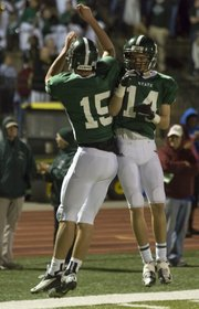 Free State's Kyle McFarland (15) and Tye Hughes (14) celebrate McFarland's touchdown during Free State's game against Olathe North, Friday, Nov. 2, 2012 at FSHS. The Firebirds defeated the Eagles 38-22 and advanced to the next round in the playoffs.
