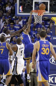 Memphis Grizzlies&#39; Zach Randolph (50) makes contact with Golden State Warriors&#39; Brandon Rush (4) during the first half of an NBA basketball game Friday, Nov. 2, 2012, in Oakland, Calif. Rush left the game with an injured knee after this play.