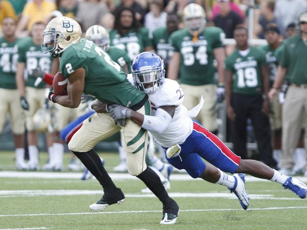 Kansas safety Dexter Linton drags down Baylor receiver Terrance Williams during the first quarter, Saturday, Nov. 3, 2012 at Floyd Casey Stadium in Waco, Texas.