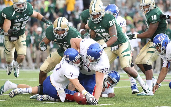 Kansas players Kale Pick (7) and Tanner Hawkinson (72) collide as they try to recover a fumble by running back James Sims, back, during the third quarter against Baylor, Saturday, Nov. 3, 2012 at Floyd Casey Stadium in Waco, Texas.