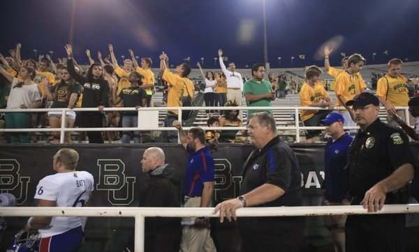 Kansas head coach Charlie Weis heads off the field as the Baylor student section sings their Alma Mater following the Jayhawks&#39; 41-14 loss to the Bears, Saturday, Nov. 3, 2012 at Floyd Casey Stadium in Waco, Texas.
