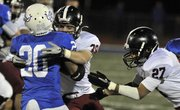 Lawrence High's Kieran Severa (39) wraps up Gardner running back Traevohn Wrench (20) during their Class 6A state playoff game on Friday, Nov. 2, 2012, at Gardner.