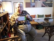 Grant Goodman, 88, a retired Kansas University professor of history, shows the Lawrence Journal-World a letter he received Saturday. He said he has no idea why the government chose to open it.