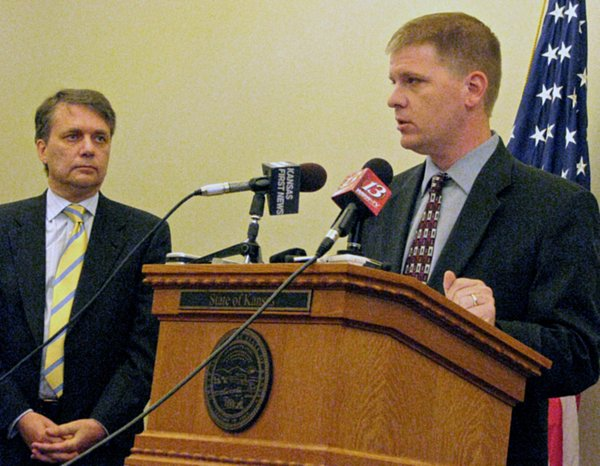 KDADS Secretary Shawn Sullivan at the podium during Monday&#39;s press conference about the waiting list for home and community-based Medicaid services for the physically disabled. To his left is Lt. Gov. Jeff Colyer.