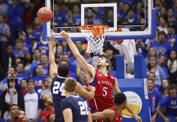 Kansas center Jeff Withey swats a shot from Washburn forward Zack Riggins during the first half on Monday, Nov. 5, 2012 at Allen Fieldhouse.