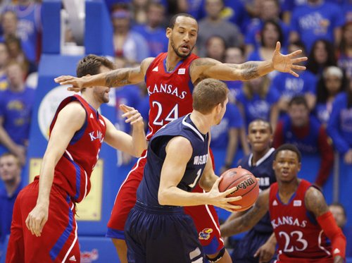 Kansas guard Travis Releford looks to defend a pass from Washburn forward Christian Ulsaker during the first half on Monday, Nov. 5, 2012 at Allen Fieldhouse.