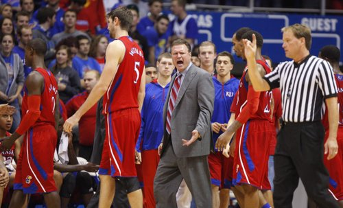 Kansas head coach Bill Self has words for game official John Higgins after a call in question went the way of Washburn during the first half on Monday, Nov. 5, 2012 at Allen Fieldhouse.