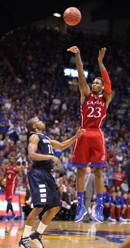 Kansas guard Ben McLemore hoists a three over Washburn guard Kyle Wiggins during the first half on Monday, Nov. 5, 2012 at Allen Fieldhouse.