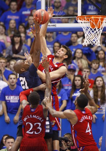Kansas center Jeff Withey comes over the top to block a shot by Washburn forward Joseph Smith during the second half on Monday, Nov. 5, 2012 at Allen Fieldhouse. Withey finished the game with seven blocks.