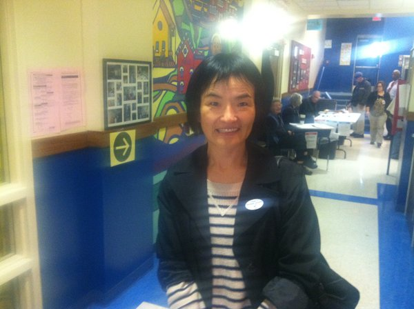 Xueying Wang, originally from China, voted Tuesday in her first election as a U.S. citizen.