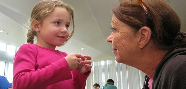 Savannah Johnson, 4, waits with her grandmother, Joyce Corwin, for a WIC visit with Lawrence-Douglas County Health Department. They live in Baldwin City. Budget plans being considered by the administration of Gov. Sam Brownback could mean cuts in state aid to local health departments.