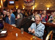Lawrence resident Elizabeth Stewart, right, reacts as it is announced that Iowa's electoral votes will go to President Barack Obama during a democrat watch party on Tuesday, Nov. 6, 2012 at The Dynamite Saloon, 821 Massachusetts.