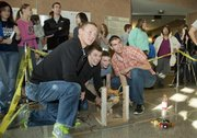 Members of the Lawrence High School Lions team Three fire their catapult during the Kansas University School of Engineering's High School Design competition Tuesday at Eaton Hall on the KU campus. Teams competed in accuracy and velocity events. The Lions Three team was made up of students from Lawrence High School's engineering design class, which includes students from Free State High School. From left are seniors Wilson Hack, of Free State, Austin Abbott, of Lawrence High, Tyler Bradfield, of Lawrence High and Logan Bannister, of Free State.