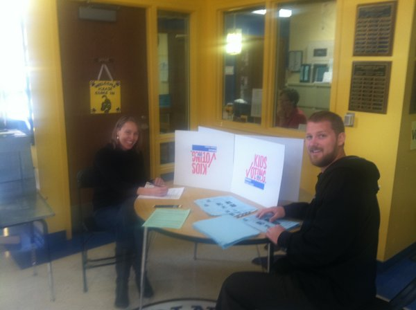 Kids Voting workers Jay Taylor and Shelli Ulmer spent Election Day morning counting votes from Pinckney Elementary students.