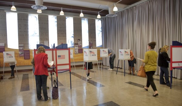 The majority of voting booths are occupied shortly before noon at the Carnegie building voting precinct Tuesday, Nov. 6, 2012. Polls close at 7 p.m. Tuesday.