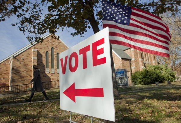 A voter heads to a polling precinct at Central United Methodist Church before noon Tuesday, Nov. 6, 2012.