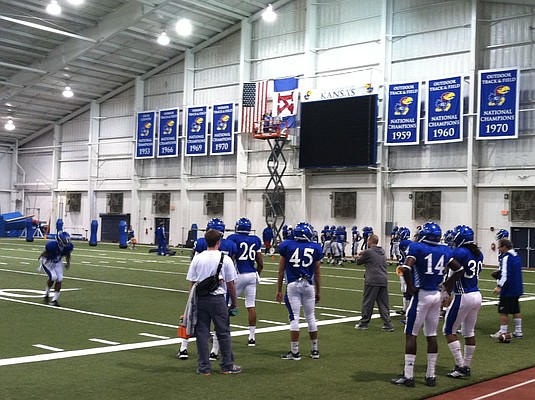 Wednesday's KU football practice was moved indoors to better prepare for warm temperatures expected in Lubbock this weekend.