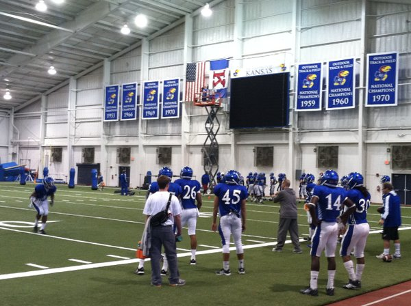 Wednesday&#39;s KU football practice was moved indoors to better prepare for warm temperatures expected in Lubbock this weekend. 