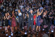 President Barack Obama and wife Michelle is holds hands with Vice President Joe Biden and his wife Jill following Obama's victory speech to supporters in Chicago early Wednesday, Nov. 7 2012.