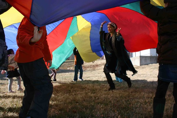 "Hailey Gillespie and students play with a parachute during a recent ""School's Out, Theatre's In"" workshop"