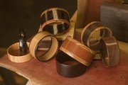 Paul Kincaid has been turning wood into fashionable bracelets since picking up woodworking as a hobby last year. He gives the bracelets away.
