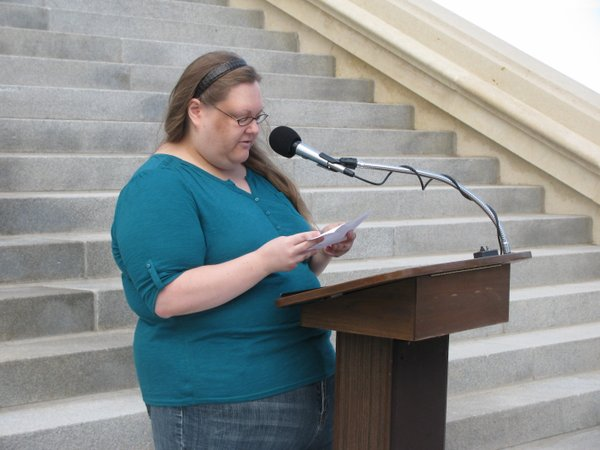 Jennifer Weishaar of Lawrence speaks at rally.