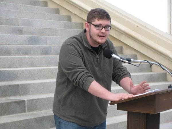 Will Dale, a Kansas University junior from Topeka, speaks to rally-goers.
