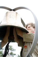 "HOAC-BSA Troop 54 Eagle Scout Casey Jones attaches the clanger to the bell from the USS Neosho before the ""Let Freedom Ring"" ceremony and dedication of the bell at the VFW Post #6654 in De Soto on July 4, 2010."