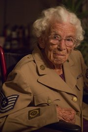 Emma Pogge, Lawrence, is 100 years old and one of the oldest living World War II women veterans. She enlisted in the Womens Army Corps in 1943 and served both in the United States and overseas. She can still wear her WAC uniform.