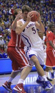 Kansas center Jeff Withey works the paint against Southeast Missouri&#39;s Colin Ferguson on Friday at Allen Fieldhouse.