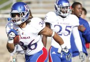 Kansas running back Taylor Cox practices receiving kickoffs prior to the start against Texas Tech on Saturday, Nov. 10, 2012 at Jones AT&T Stadium in Lubbock, Texas.