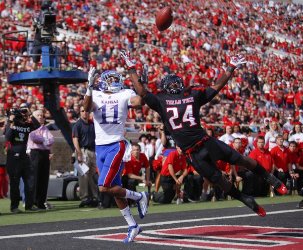 Kansas receiver Tre' Parmalee has a would-be touchdown pass knocked away by Texas Tech defensive back Bruce Jones during the second quarter on Saturday, Nov. 10, 2012 at Jones AT&T Stadium in Lubbock, Texas.