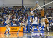 Kansas' Tayler Tolefree (5) and Texas' Molly McCage battle it out at the net during Kansas' volleyball match against Texas, Saturday, Nov. 10, 2012 at the Horejsi Center.